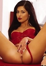 Evelyn Lory shoves a silver dildo in...